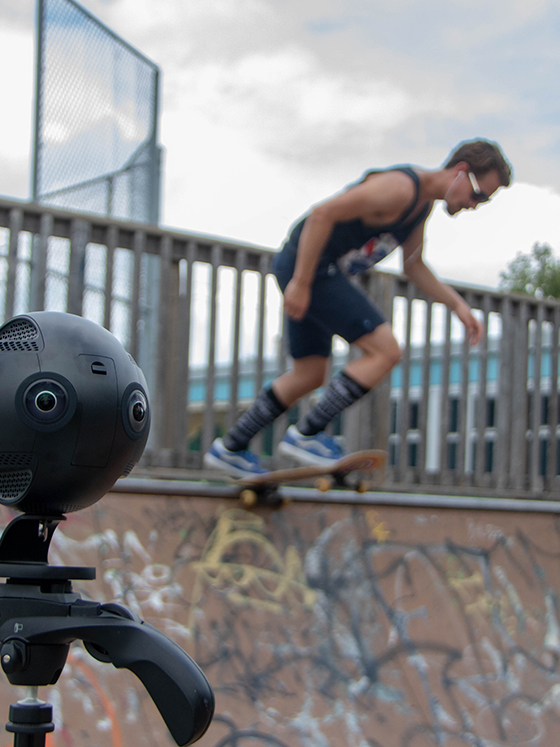 a 360 vr cam set up on a half pipe with a skateboarder about to ride