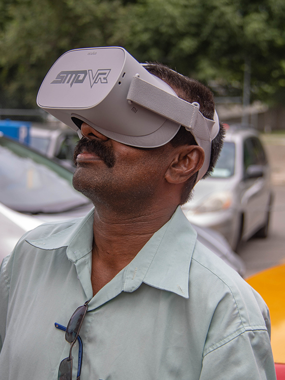 Cab driver wearing an SMDVR Oculus GO virtual reality headset