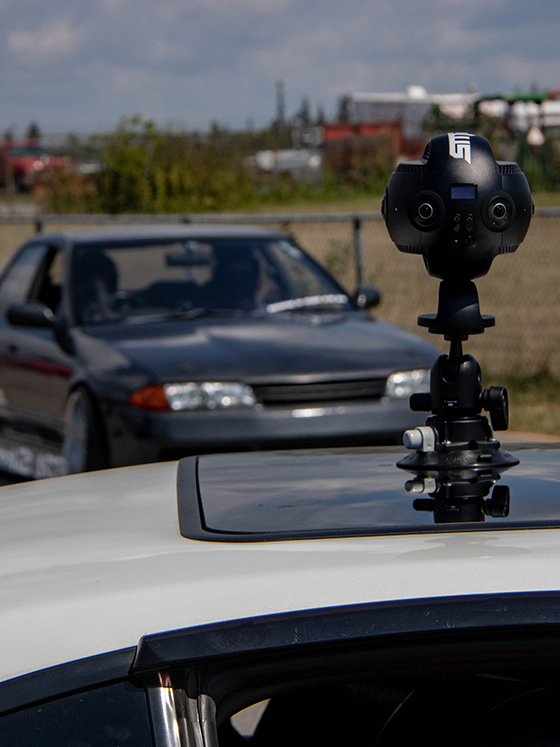 a 360 vr camera mounted to the top of a drift car
