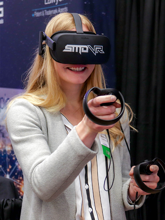 A woman wearing an oculus rift headset provided by SMDVR
