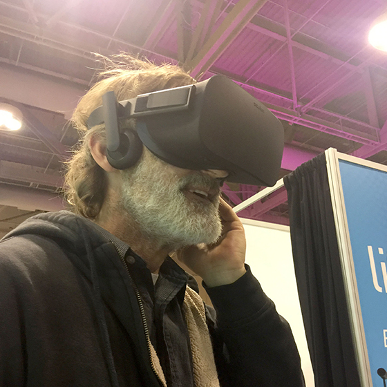 an older man wearing a virtual reality headset enjoying the Lift & Co. Virtual Reality experience powered by SMDVR